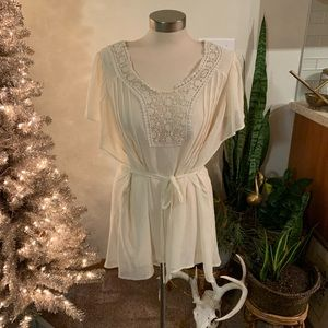 Cream blouse with tie waist and flutter sleeves